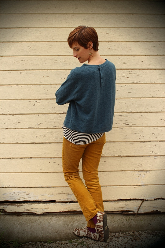 gold cords and blue top